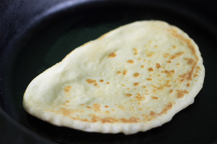 This bread is easily made. Homemade naan is actually similar to a flatbread, but even better. Extra flavor is added from the yougurt and butter. Yum!