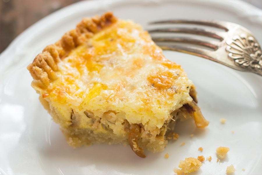 This caramelized onion cheddar tart is both sweet and salty, flaky and creamy, buttery and hearty. Easy to make ahead, so do it!