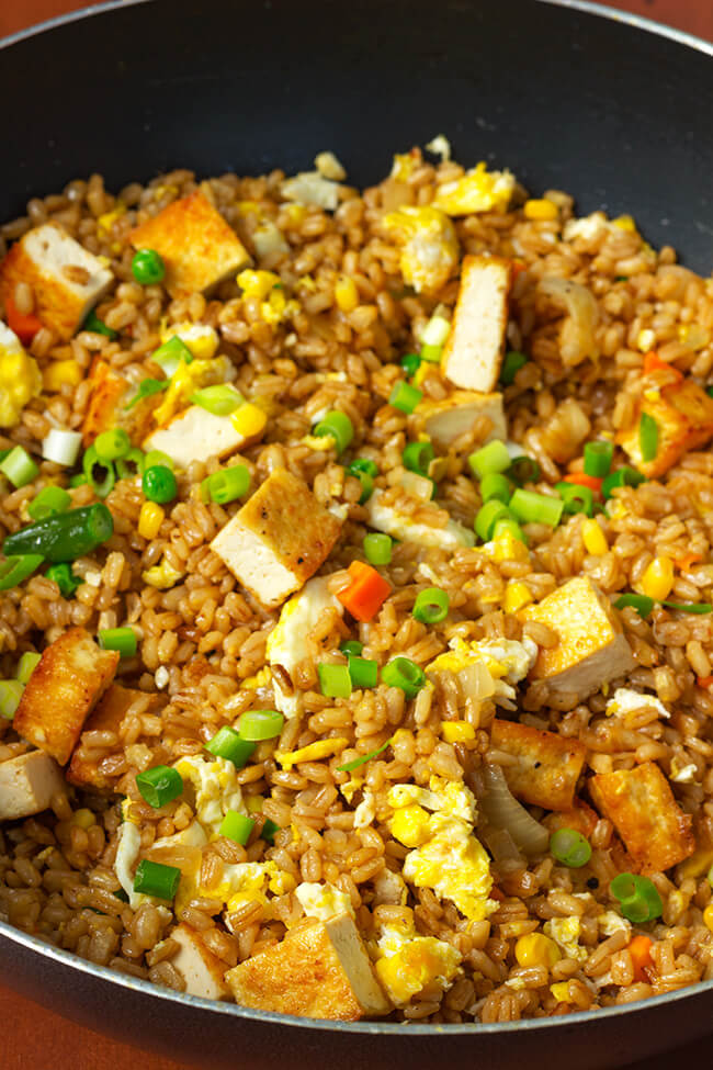 I love when I can take a twist on a popular dish. This super easy tofu barley fried rice is a flavorful, filling and can be prepared in 20 minutes. That's faster than take out, not to mention more nutritious.
