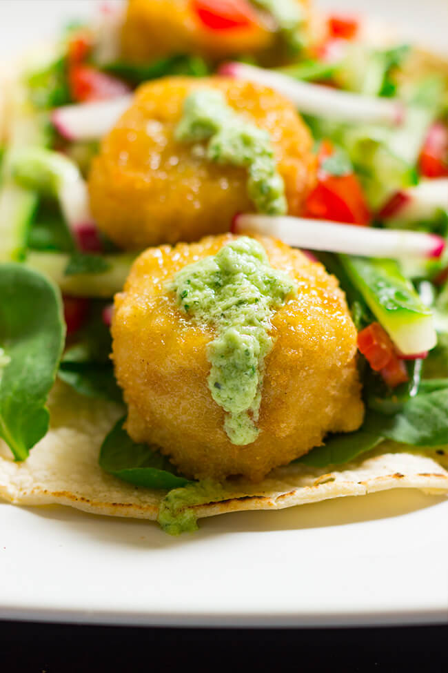 These vegetarian tacos with avocado mint sauce are the perfect way to have a easy and healthy week night dinner that is full of flavor.