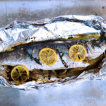 This oven roasted sea bass recipe makes the fish flaky, moist and perfectly seasoned with spices. It is cooked in foil so clean up is a breeze.