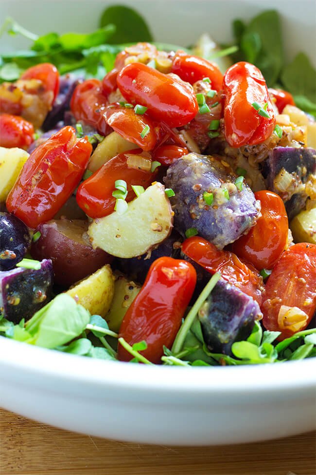 Warm tomato and potato salad is one of my favorite salads of all time. Vegetables are generously tossed in a mustard vinaigrette and served over a mix salad.