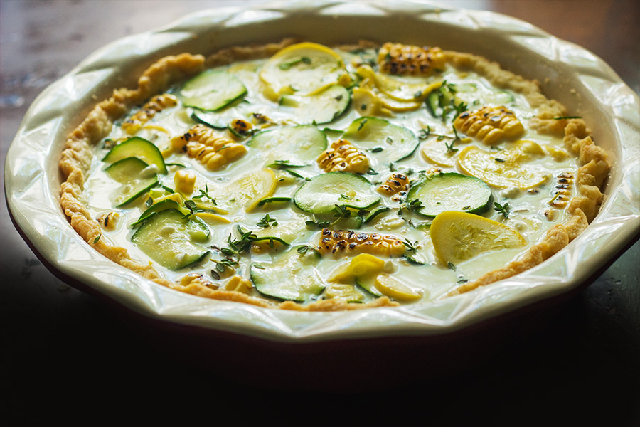 This summer squash roasted corn tart has thinly sliced yellow summer squash, zucchini, and roasted corn are tossed in shallots, thyme, goat cheese and garlic then topped with Gruyere cheese- I don't see how that can be any kind of bad.