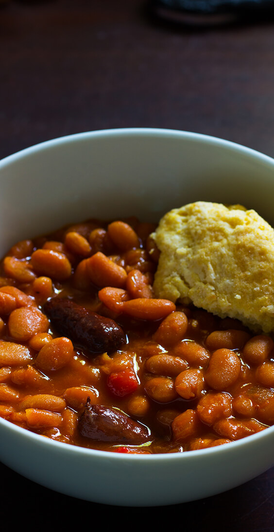 Homemade slow cooker baked beans is already one of my favorite dishes. Just five basic ingredients: sausages, navy beans, molasses, sriracha and mustard.