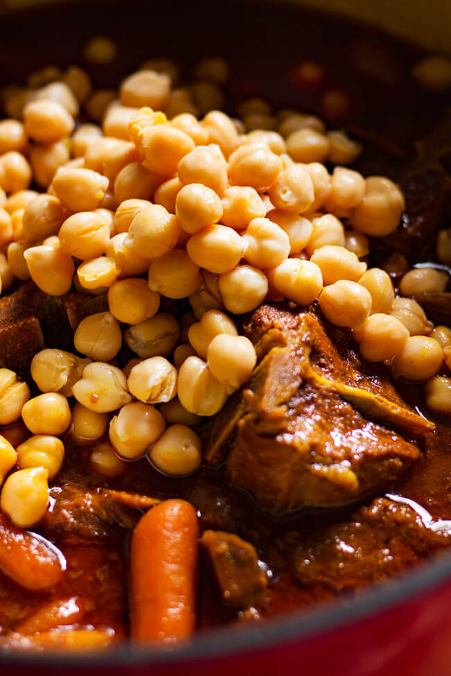 This Curry Lamb Chickpeas Stew is the perfect recipe for rainy days. It is warming and slightly spicy. It is also packed with vegetables and tender lamb.