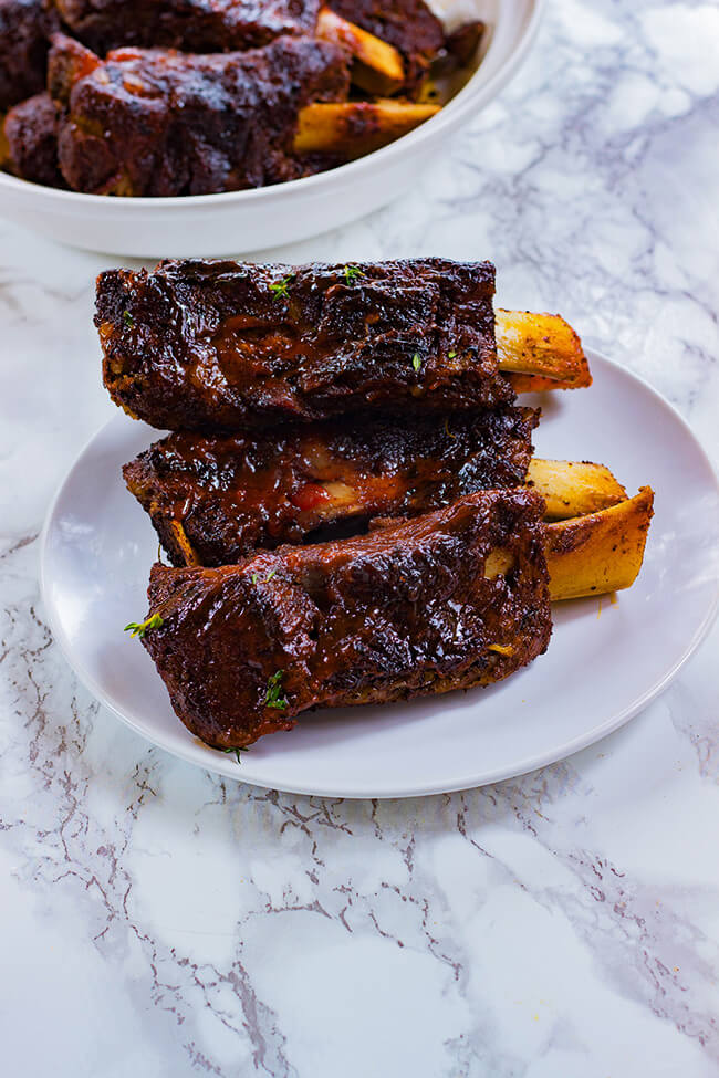 These easy oven baked jerk beef ribs are seasoned to the bone, slow braised, tender and juicy. These ribs will be a hit- fall off the bone perfection!