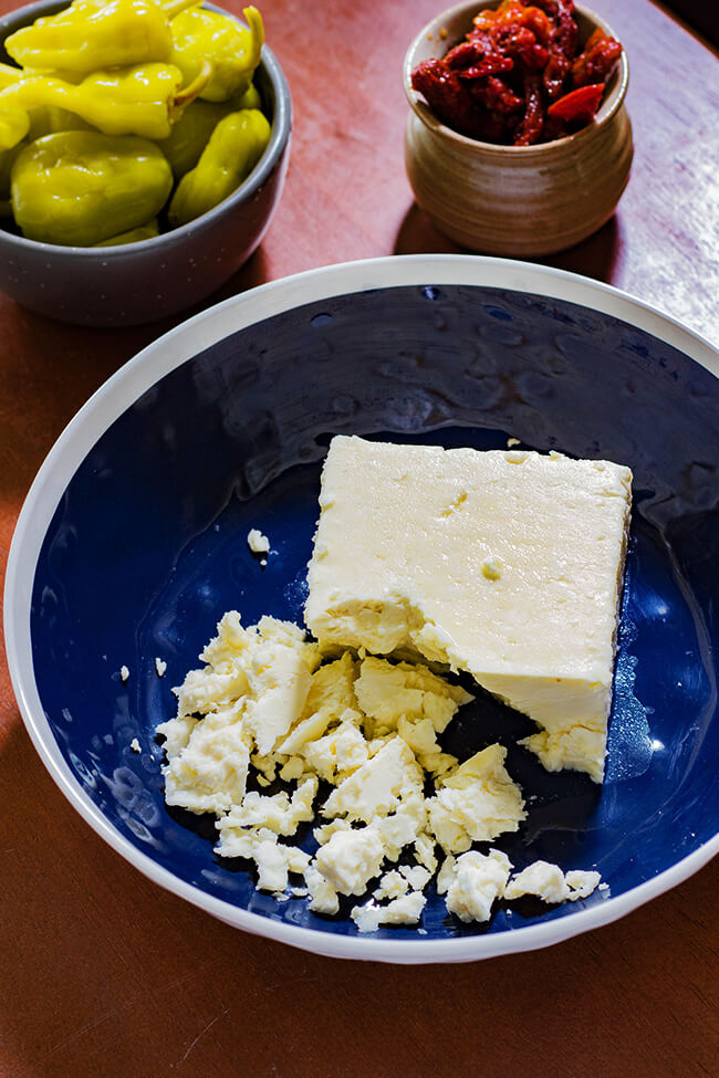 This Whipped Greek Feta Dip recipe is tang, a tad spicy and incredibly cream. It packs a punch to any chip or sandwich.