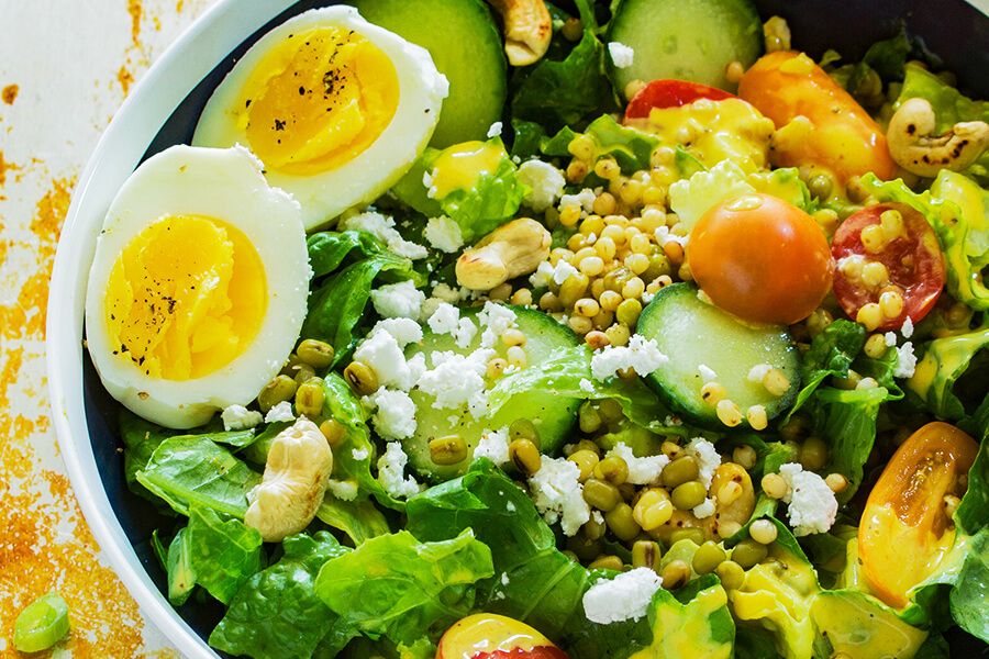 This Summer Harvest Sorghum Salad recipe has sweet ripe tomatoes, crisp lettuce creamy goat cheese & toasted cashews covered in creamy curry dressing.