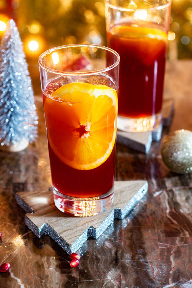 Bright and pleasantly tart, this orange pomegranate punch can be served with or without sparkling soda.
