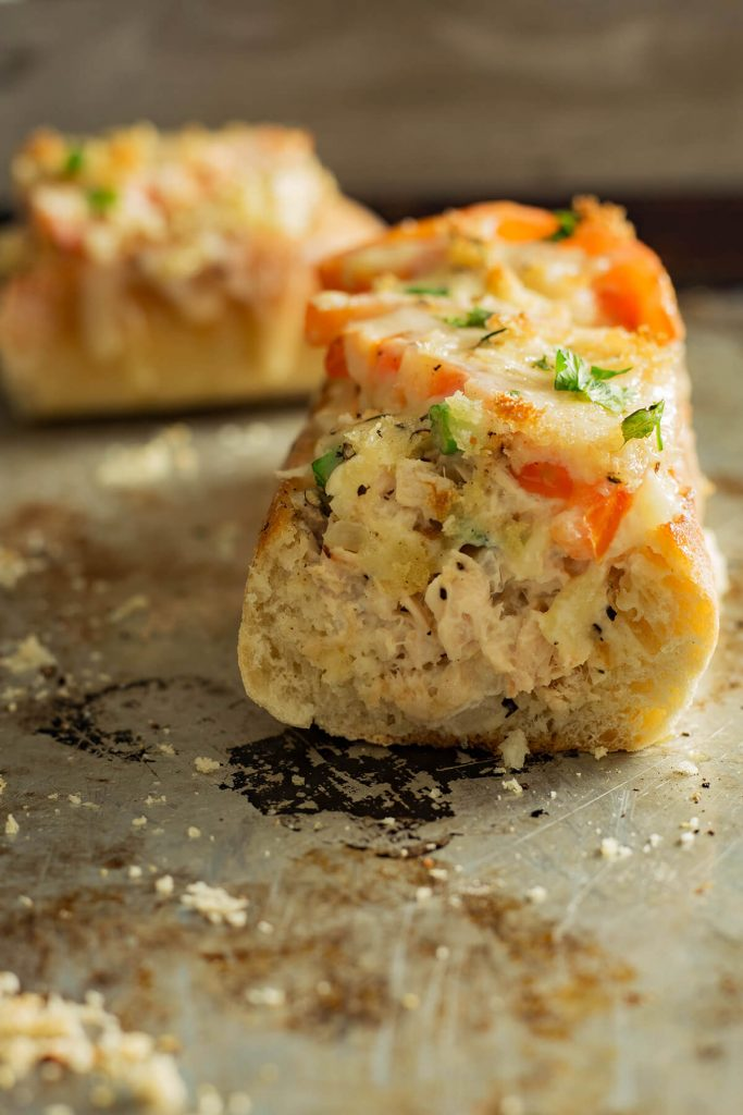 This cheesy Tuna Melt as a lunch or dinner entrée. This tuna melt is filled with creamy tuna salad topped with tomatoes and bubbling cheese that please a small or large crowd.
