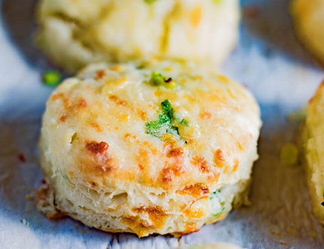 This Cheddar Scallion Biscuits Recipe makes the most tender, delicious, fluffy and cheesy biscuits. It is currently raining cats and dogs in Florida and these made the perfect addition to any soup or stew.